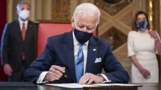 US President Joe Biden signs three documents including an Inauguration declaration, cabinet nominations and sub-cabinet noinations in the Presidents Room at the US Capitol after the inauguration ceremony to making Biden the 46th President of the United States in Washington, DC, USA, 20 January 2021.