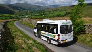 Photo showing a Western Dales Bus driving through countryside