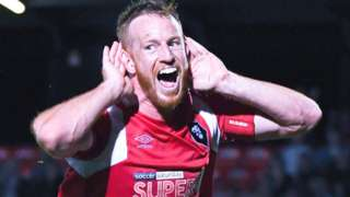 Adam Rooney in action for Salford City