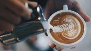 Athenkosi makes latte art