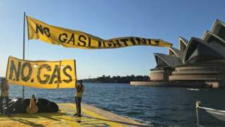Climate activists protesting on a barge in Sydney Harbour against gas expansion plans