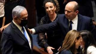Benjamin Netanyahu and Naftali Bennett in the Knesset (13 June)