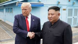 Trump shakes hands with Kim