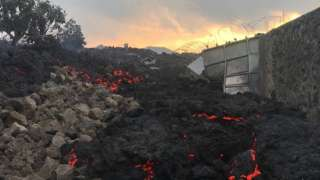 Smouldering ashes are seen early morning in Goma in the East of the Democratic Republic of Congo on 23 May 2021 following the eruption of Mount Nyiragongo
