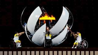 The Paralympic flame is lit by, from left, Shunsuke Uchida, Yui Kamiji and Karin Morisaki during the Opening Ceremony of the Tokyo 2020 Paralympic Games at the Olympic Stadium in Tokyo, Japan.