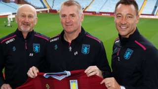 Dean Smith (centre), with assistant head coaches John Terry (right) and Richard O'Kelly (left)