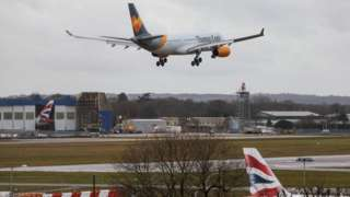 An aircraft comes in to land as the runway is reopened at Gatwick Airport