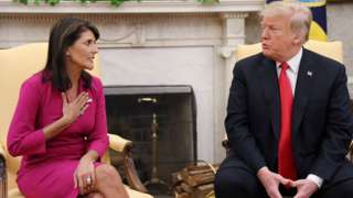 Outgoing US Ambassador to the United Nations Nikki Haley talks with President Donald Trump in the Oval Office