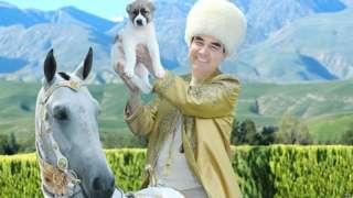 Turkmen leader on horseback holding a puppy