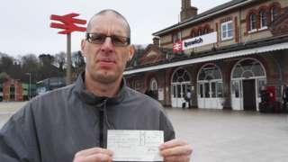 Seph Pochin holding his cheque