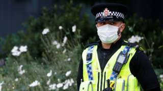 GMP officer in face mask