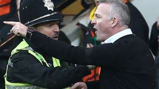 Ipswich manager Paul Lambert restrained during East Anglian Derby