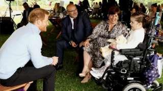 Prince Harry and an award winner