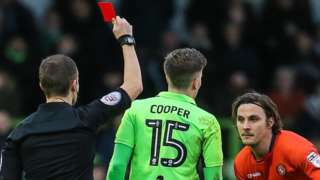 Forest Green Rovers midfielder Charlie Cooper is shown a red card against Wycombe