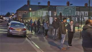 People queuing outside a polling station in Cardiff