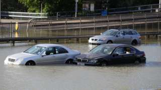 Cars stuck on a flooded North Circular