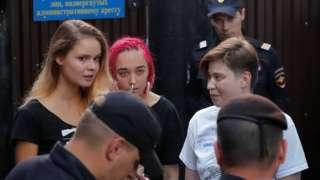 Intruders affiliated to anti-Kremlin punk band Pussy Riot, Veronika Nikulshina, Olga Kurachyova and Olga Pakhtusova, who ran onto the pitch during the World Cup final between France and Croatia, walk out of a detention center