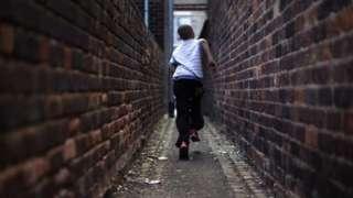 Child running through alley