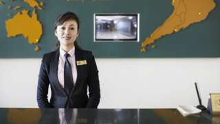 Receptionist at North Korea's Changgwangsan Hotel