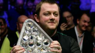 Mark Allen celebrates with the Masters trophy