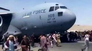 People trying to board USAF aeroplane at Kabul airport