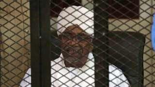 Former president of Sudan Omar al-Bashir, siddon inside cage during im sentencing
