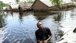 Man wey dey waka inside heavy flood