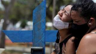 Woman reacts during the burial of her mother in Manaus