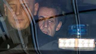 Former French President Nicolas Sarkozy is driven to the Paris prosecutor's office