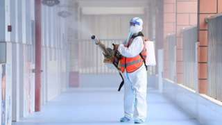 Worker disinfects primary school in Wuhan on 25 August 2021. Photo Barcroft Media