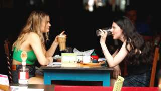 Two women eating out in a restaurant