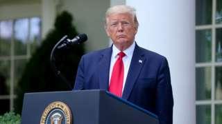 US President Donald Trump at podium