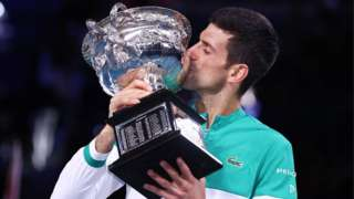 Novak Djokovic with the Australian Open trophy