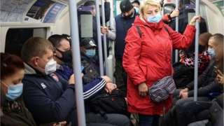 Commuters wearing masks