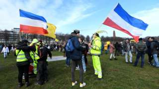 People protest against the Covid-19 restrictions in The Hague, Netherlands, on 14 March 2021