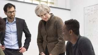 Theresa May with a pupil