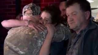 Kayla Williams hugs family