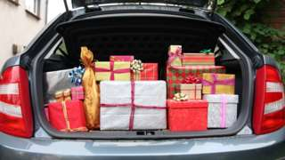 Car boot filled with presents
