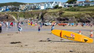 People on Polzeath beach