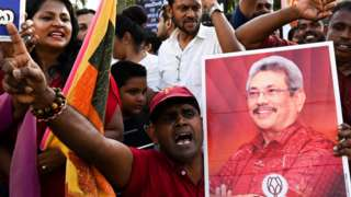"Supporters of Sri Lanka""s President-elect Gotabaya Rajapaksa shout slogans as he leaves the election commission office in Colombo on November 17, 2019."