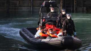 The suspected migrants on board a boat