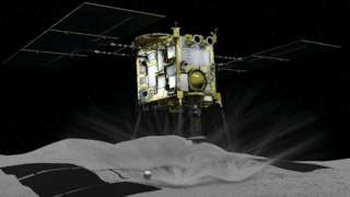 Computer graphic shows Japan Aerospace Exploration Agency's Hayabusa 2 probe touching down on an asteroid