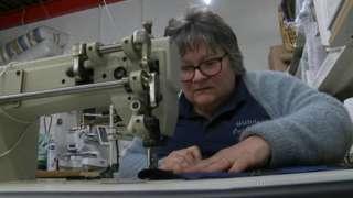 Jackie Owen on a sewing machine