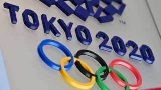 The logo for the Tokyo 2020 Olympic Games is seen in Tokyo on March 15, 2020.
