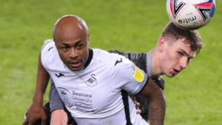 Andre Ayew of Swansea City holds off the challenge from Liam Shaw of Sheffield Wednesday