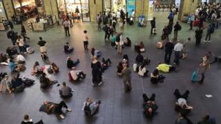 People waiting inside King's Cross station, London, as all services in and out of the station have been suspended, after a large power cut has caused