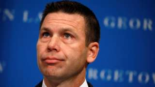 Acting Department of Homeland Security Secretary Kevin McAleenan reacts while protesters interrupt his remarks at the Migration Policy Institute annual Immigration Law and Policy Conference in Washington, October 7, 2019