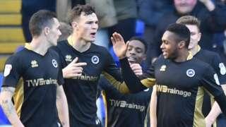 Millwall celebrate their winner at Birmingham