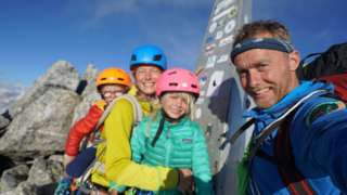 The Houlding family on the summit of Piz Badile