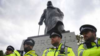 Churchill statue surrounded by police officers